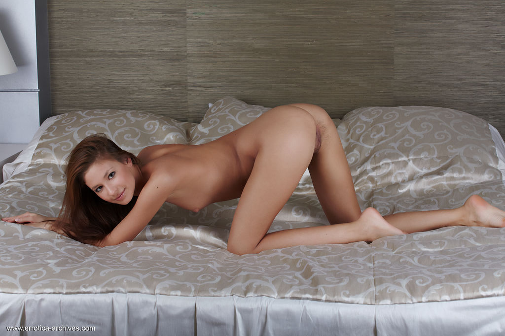 Afrodita displays her tight, slender body with trimmed pussy as she sensually poses on   the bed.