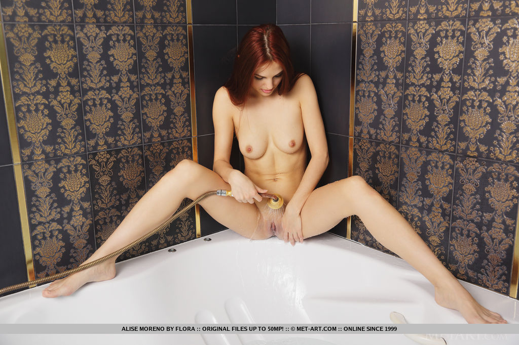 Alise Moreno dips in the bathtub as she flaunts her wet, naked body and smooth pussy.
