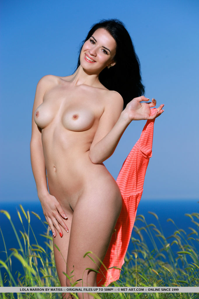 Beautiful Lola Marron playfully poses on the grassy field as she flaunts her   gorgeous body and gorgeous tits.