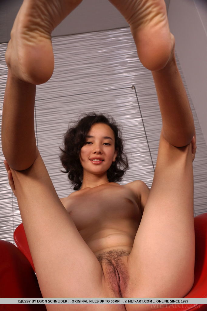 Diessy shows off her nubile body and unshaven   pussy as she poses on the chair.