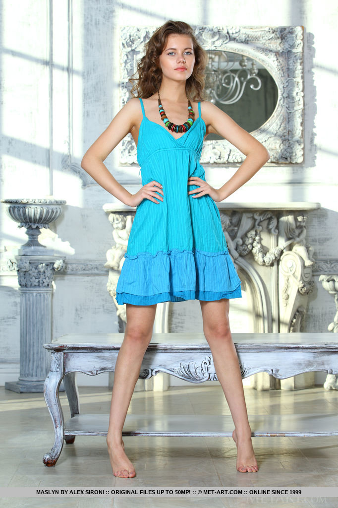 Her turquoise dress brings out her stunning blue eyes, Maslyn undresses before the camera