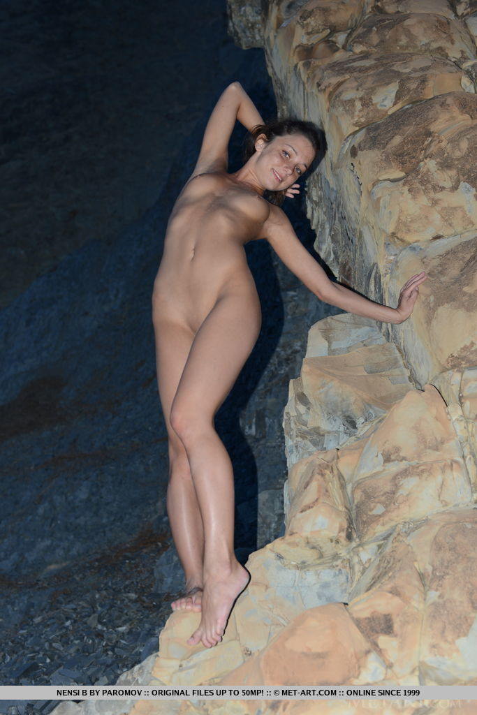 Nensi B  playfully poses by the beach as she shows off her wet, nubile body and   smooth pussy.