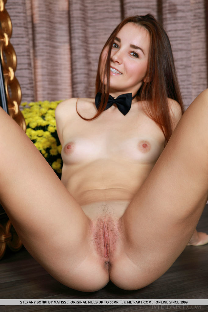 Stefany Sonri sensually poses in front of the camera with her bowtie and miniskirt.