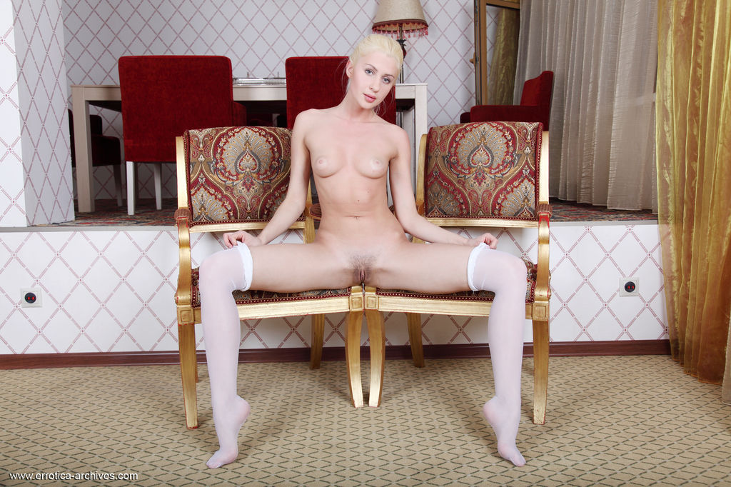 Viviene spreads her legs wide open as she bares her sweet, trimmed pussy   and delectable body.