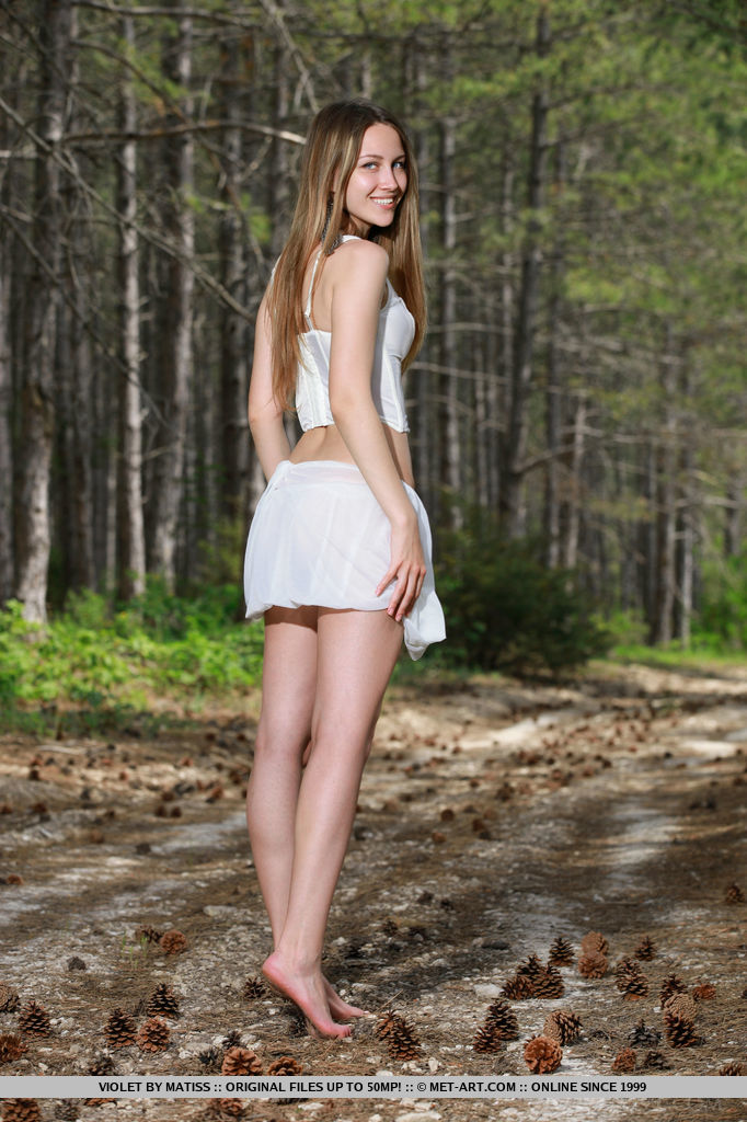 A fun and daring striptease performance in the middle of the woods with the adventurious babe, Violet