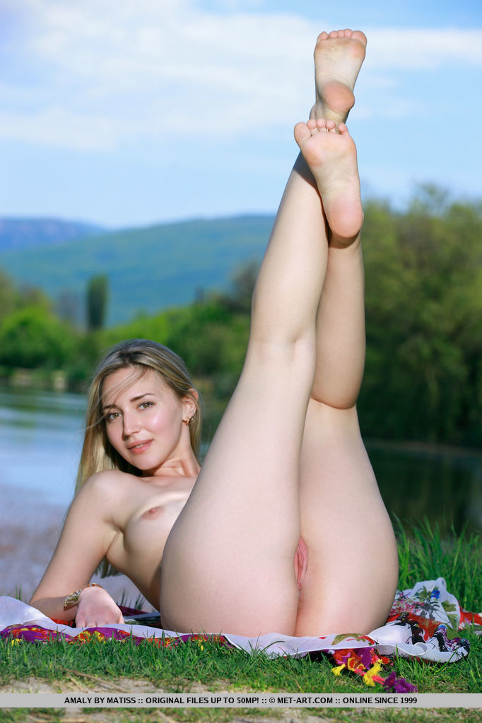 Amaly playfully poses outdoors as she shows off her gorgeous body with meaty ass and pink   pussy.