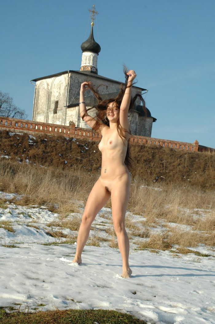 Bare girl dancing on the snow