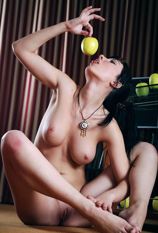 Brunette Polina D with nice soft boobs posing with apples