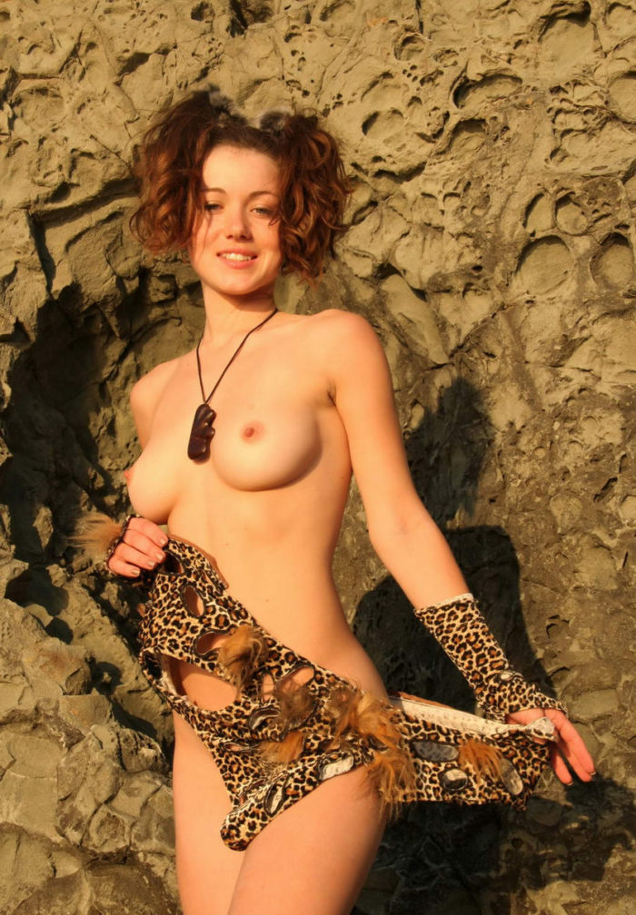 Busty teen in sexy leopard dress on the rocks