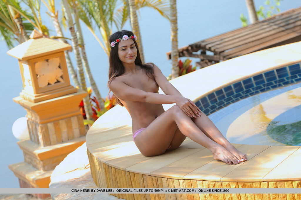 Cira Nerri delightfully poses in the outdoors   baring her petite body by the pool.