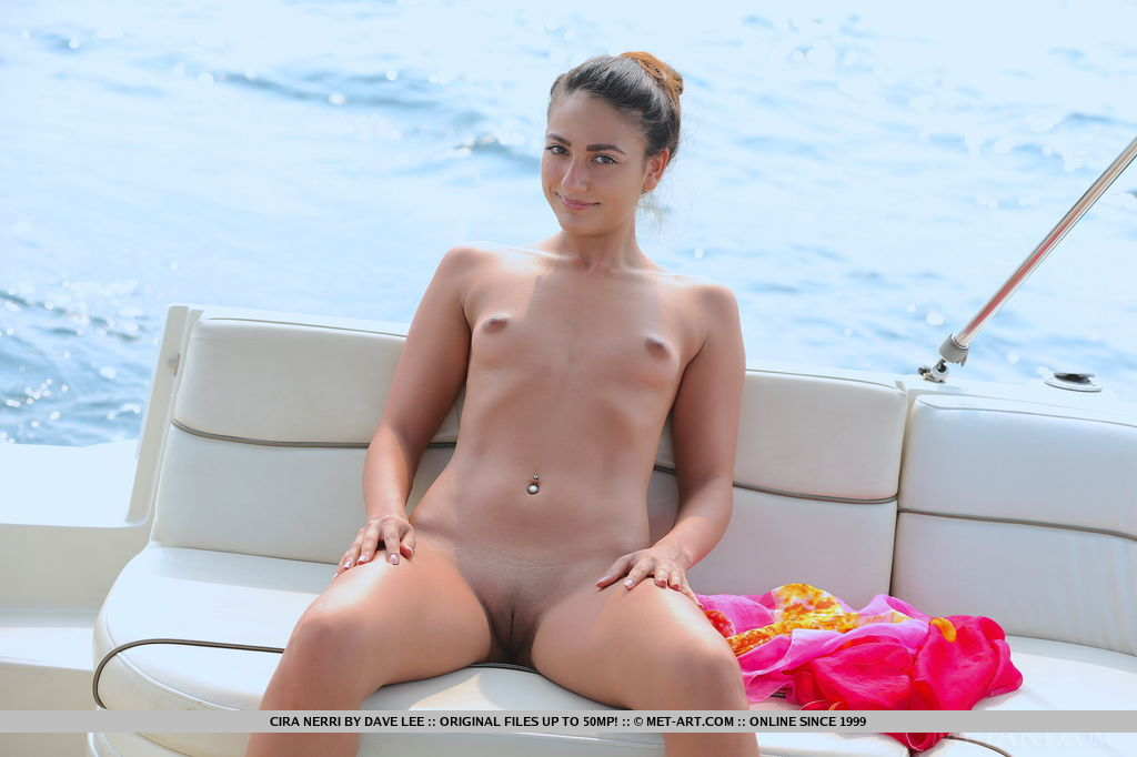 Cira Nerri sensually poses in the yacht as she bares her nubile body with perky tits and sweet pussy.