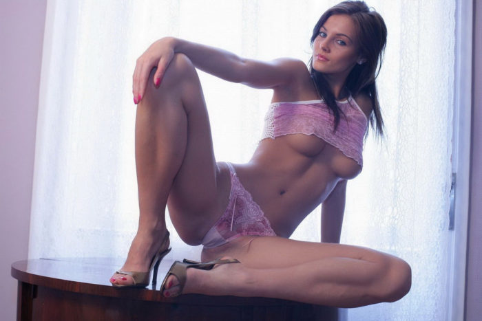 Gorgeous brunette in pink lingerie has percing in her lickable pussy