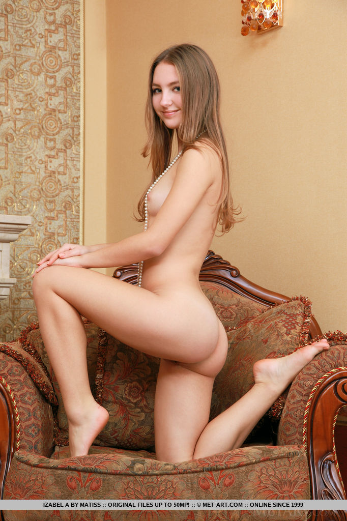 Izabel A strips her sexy lingerie as she bares her nubile body with sweet pussy on the couch.