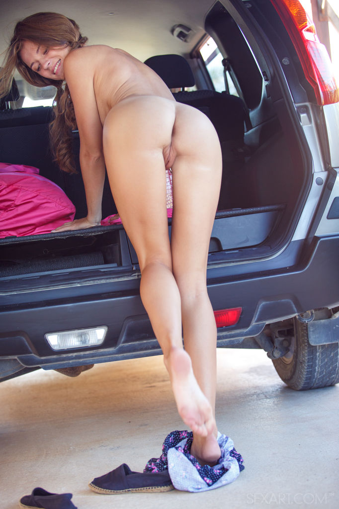 Kalisy fingers her wet, pink cunt at the back of her car