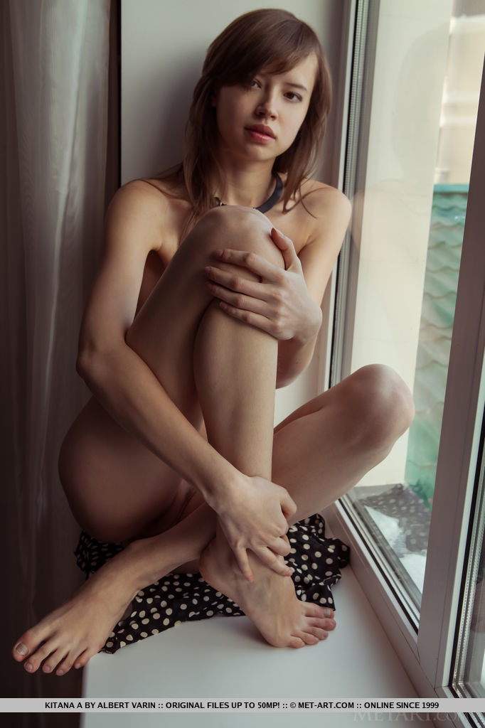 Kitana A strips her dress baring her lean, petite body with perky tits as she poses by the   window.
