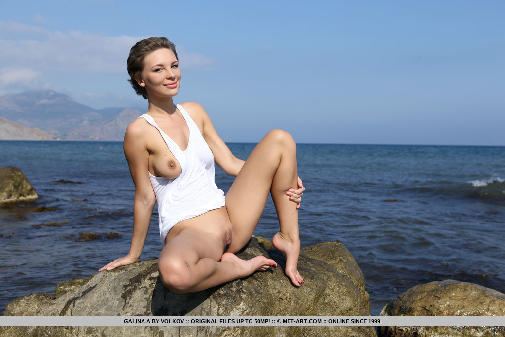 Like a beautiful sea nymph, Galina A takes off her white shirt and basks naked under the morning sun