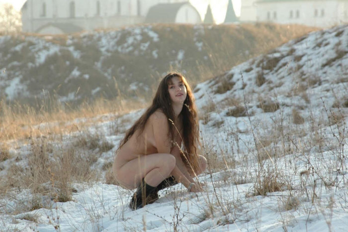 Naked girl at frozen field
