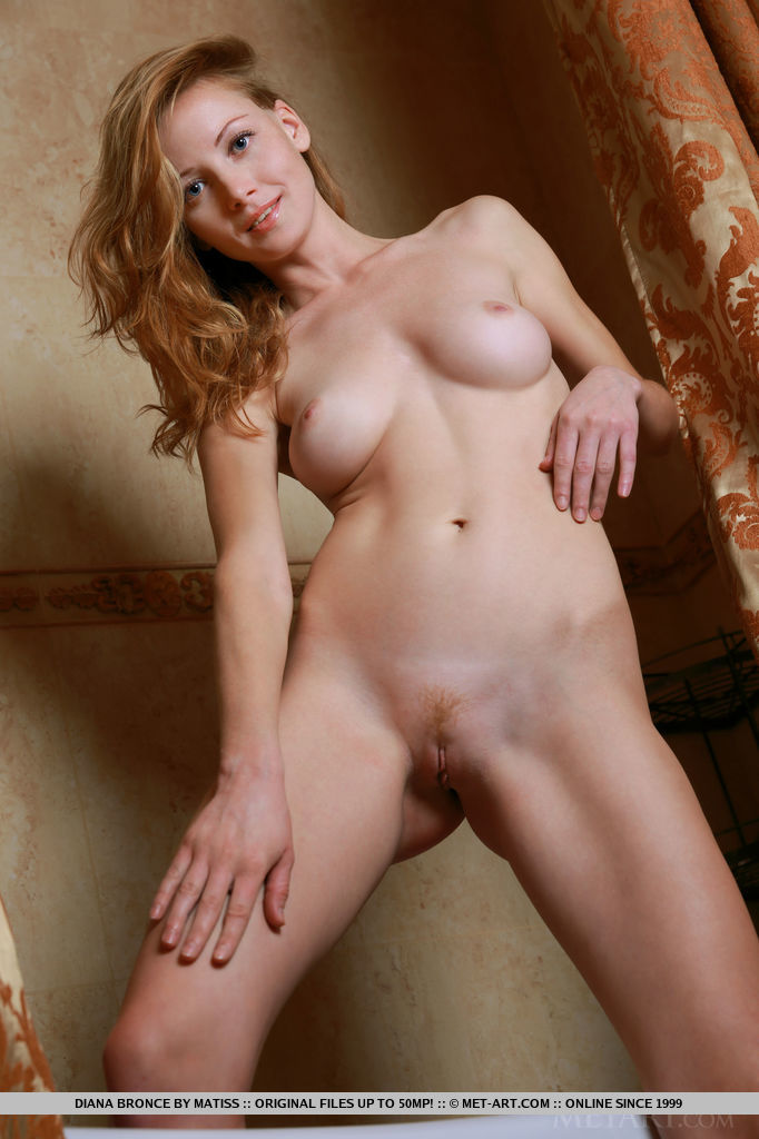 Newcomer Diana Bronce shows off her gorgeous, slender body and sweet pussy as she poses on the bathtub.