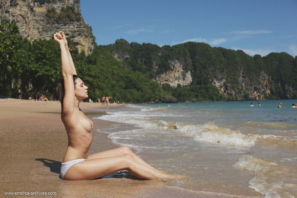 Oliana sensually poses by the beach as she shows off her wet, sexy body and sweet pussy.