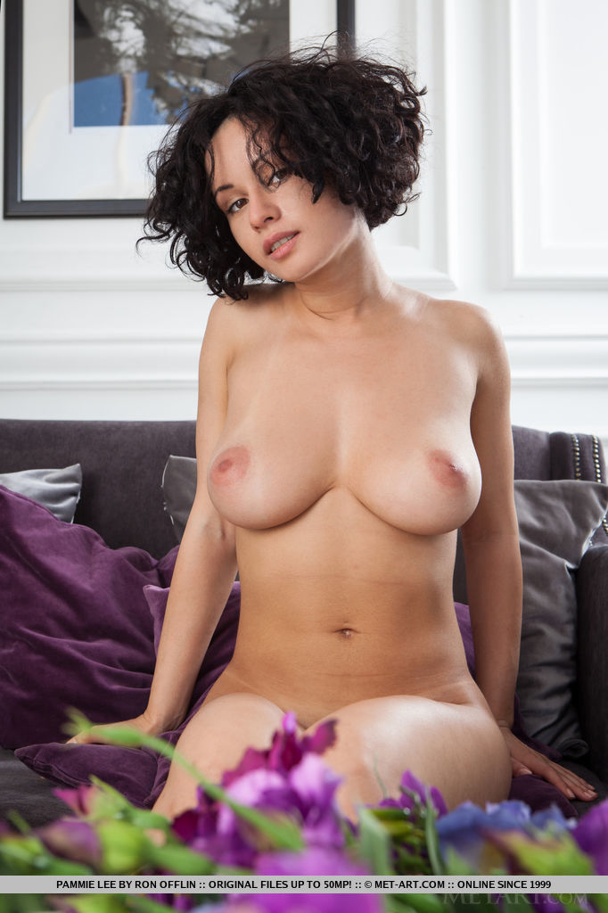 Pammie Lee's magnificent, large breasts with beautiful puffy breasts, sexy hips, and fuzzy thighs, coupled by her sweet smile