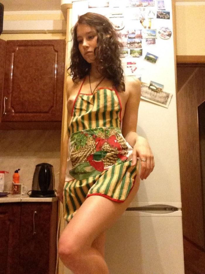 Russian amateur teen photos herself in kitchen