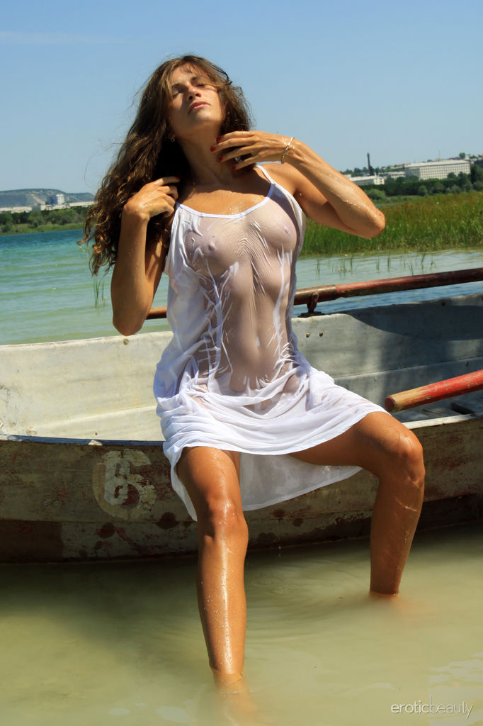 Salomja A displays her wet, sexy body as she sensually poses in the river.