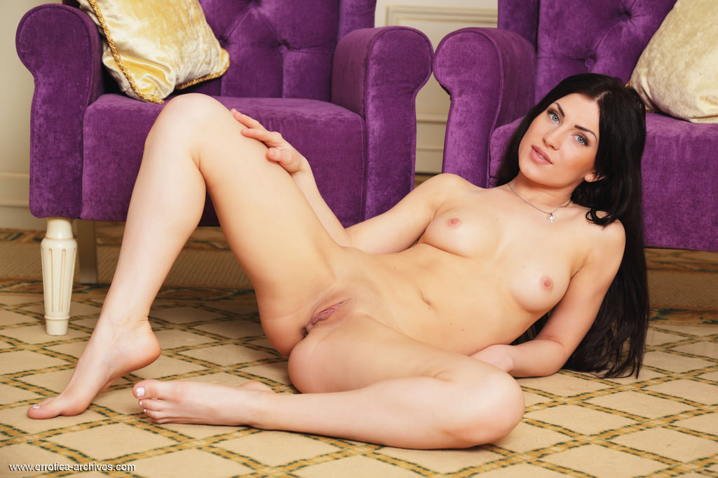 Sasha Bree erotically poses on the chair as she bares her beautiful tits and   delectable pussy.
