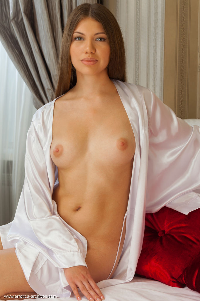 Satila sensually poses on the bed baring her luscious body with pink nipples   and pink pussy.