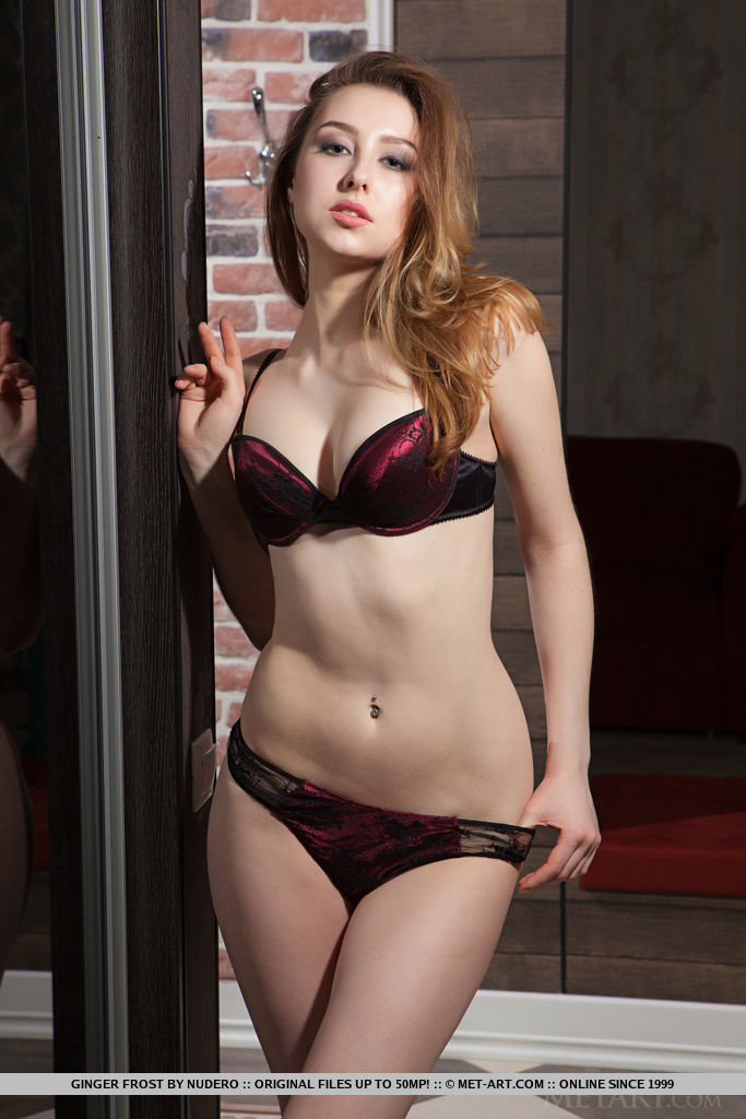 Seductive and feeling uber sexy, Ginger Frost poses in her deep magenta matching lingerie that compliments her fair, smooth body and soft lady bits