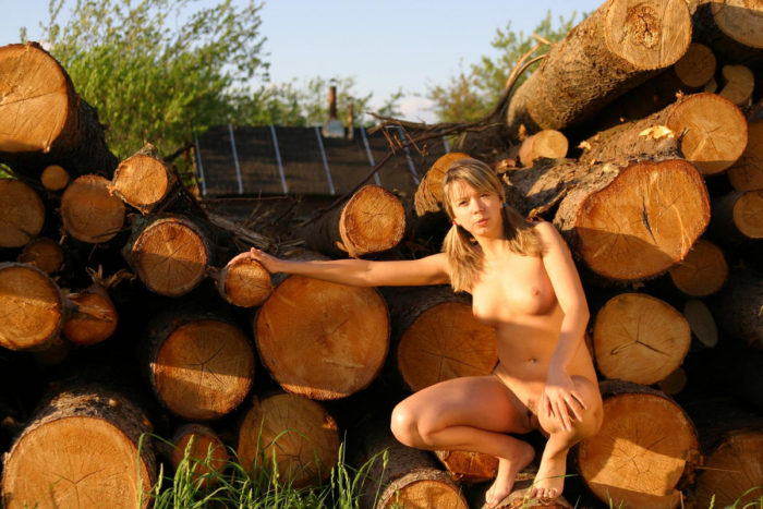 Sexy teen Alena T by the logs