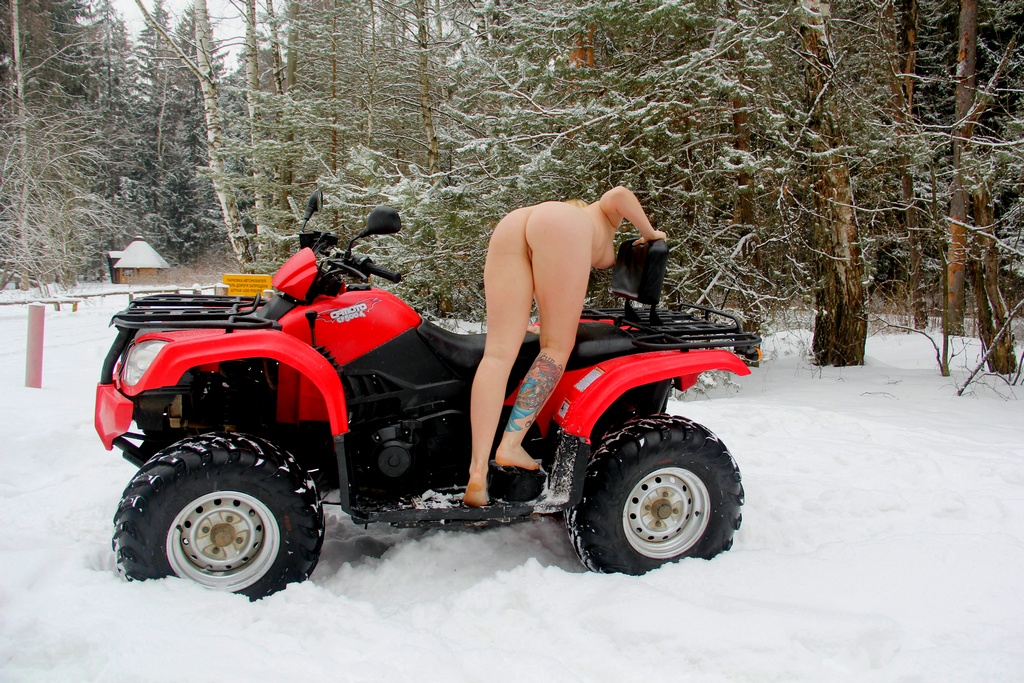 Above Naked women with atv