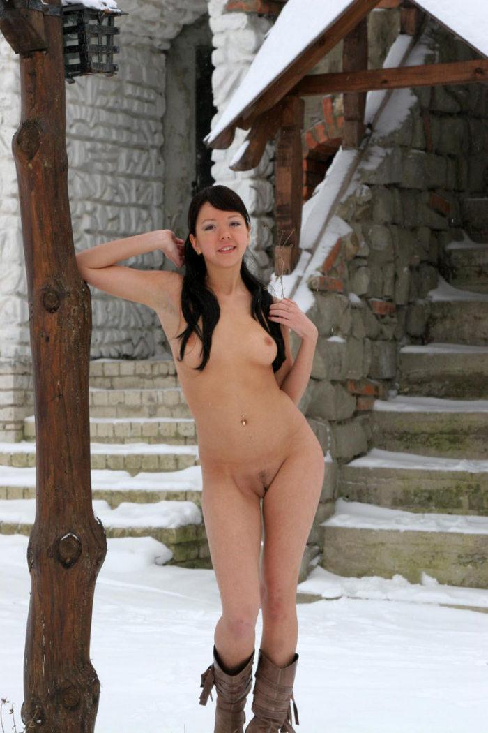 Smiling brunette loves to walk naked outdoors