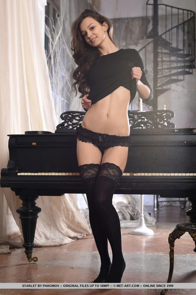 Starlet strips by the piano as she bares her sexy body, tight ass and sexy legs.