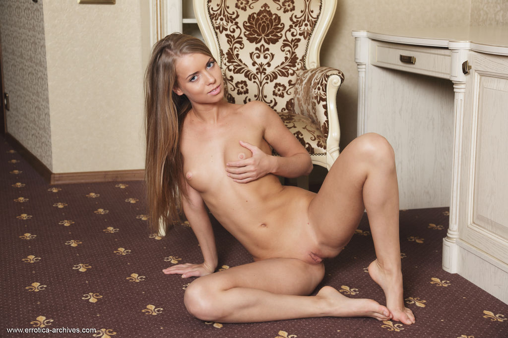 Stella Lane flaunts her slender, tight body and sweet, smooth pussy as she   poses on the table.