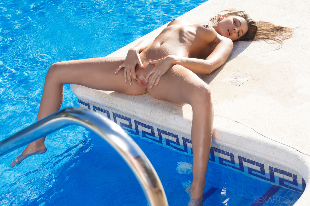 Sultry Melena A masturbates her pussy by the pool side