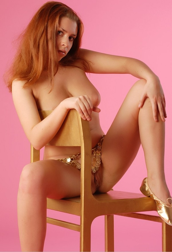Very sweet busty redhead in pink room