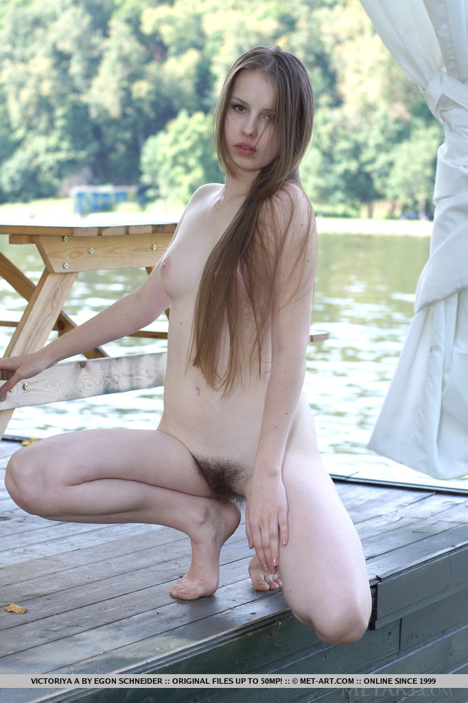 Victoriya A poses and flaunts outdoors with her sensual and tempting poses that compliments her ultra-feminine body and unshaved bush