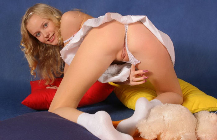 Young blonde in white socks shows all her holes with a smile