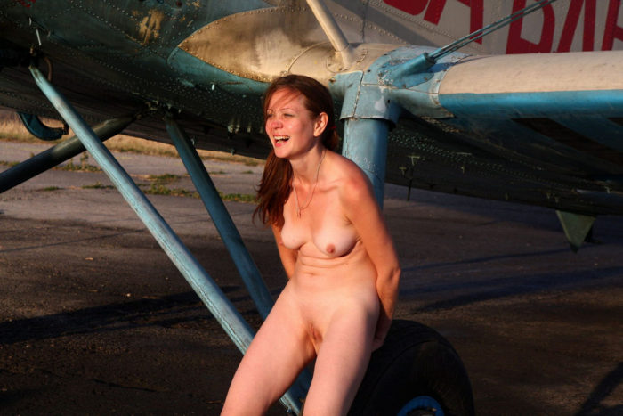 Youthfull russian redhead dame walks nude at small aerodrome