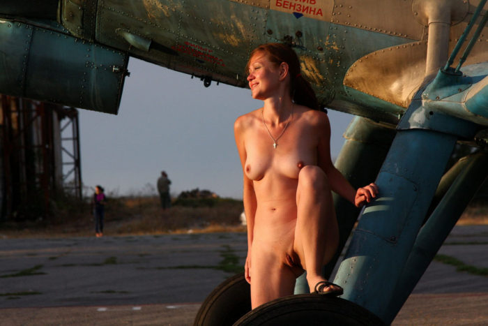 Youthfull russian redhead dame walks nude at small aerodrome