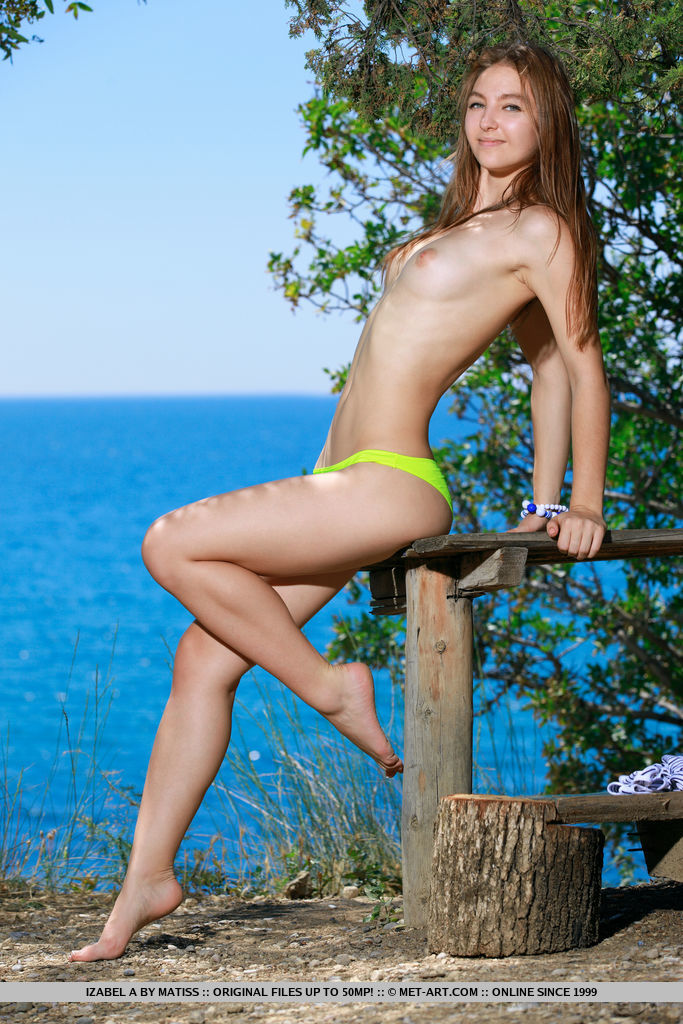 Alluring Izabel A delightfully poses outdoors as she bares her slender body and sweet pussy.
