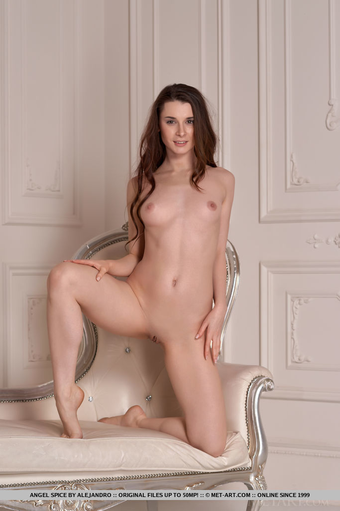 Angel Spice strips in front of the camera as she bares her   tight, slender body and smooth pussy.