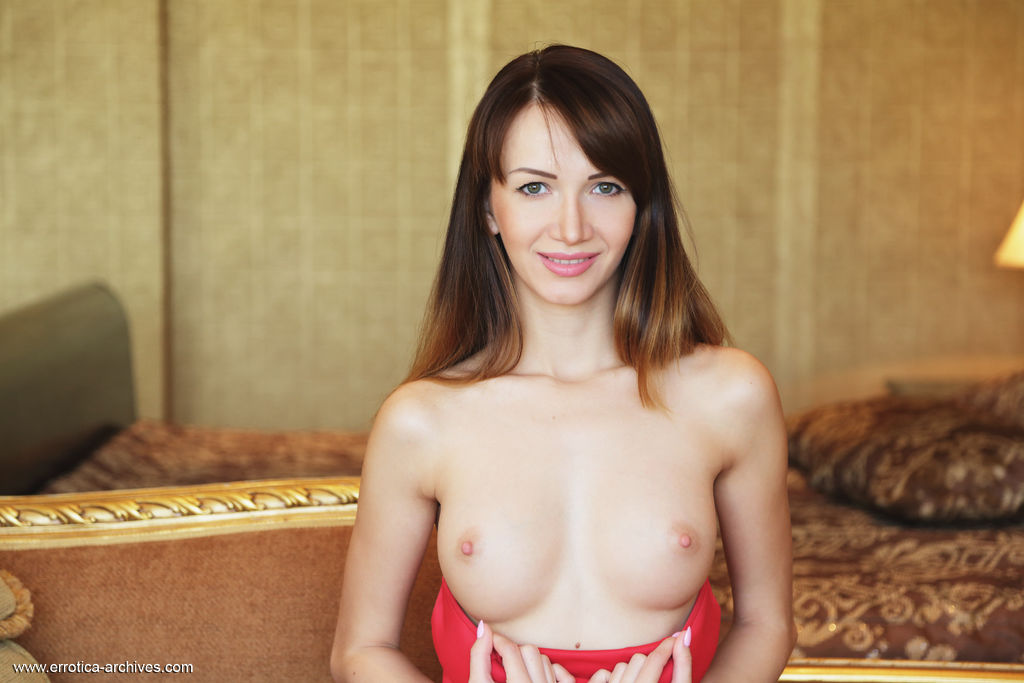Anna Violete shows off her gorgeous body with beautiful tits as she poses of the sofa.