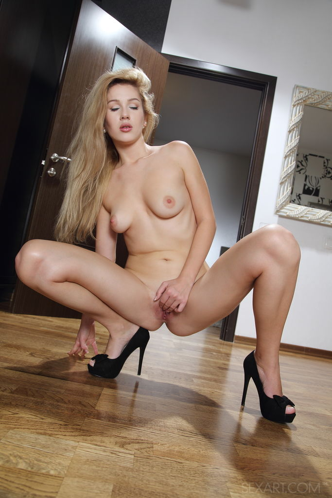 Blonde cutie Genevieve Gandi smiles charmingly as she spreads her legs wide open