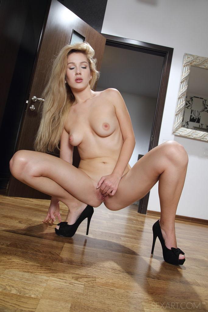 Blonde cutie Genevieve Gandi smiles charmingly as she spreads her legs wide open