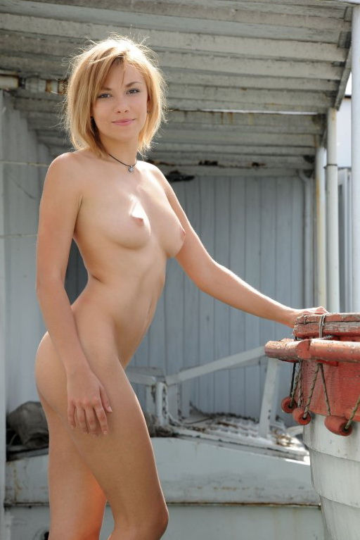 Blonde who has beautiful pussy posing on old boat