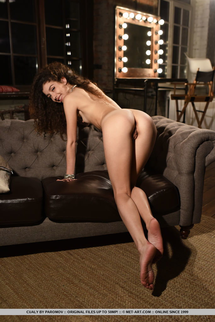 Curly Cualy bares her petite body with perky nipples as she erotically poses on the couch.