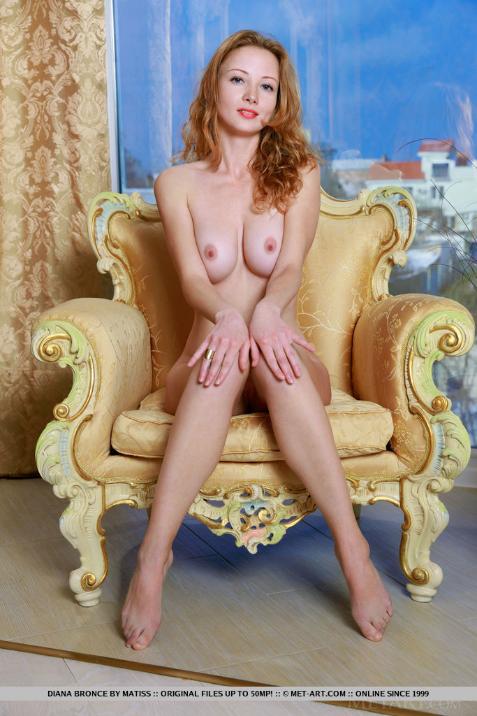 Diana Bronce flaunts her slender body with curvy hips and sexy legs as she poses on the elegant chair.