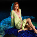 Redheaded Margarita S plays with dildo in black studio