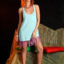 Redheaded babe Margarita S in studio